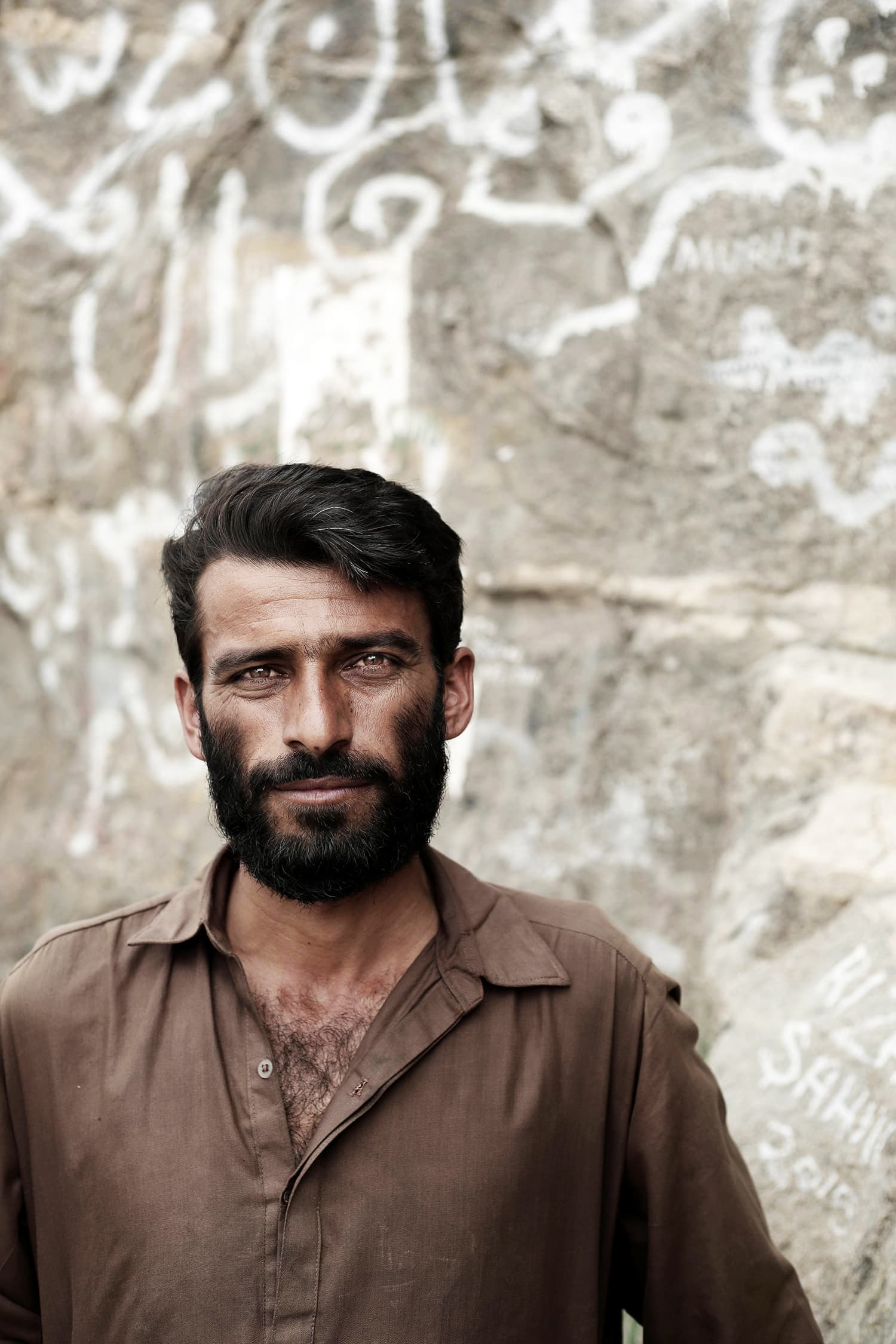 Sobdar Khan, 35, a Pakistani from Karachi poses for a portrait on Noor Mountain.— AP