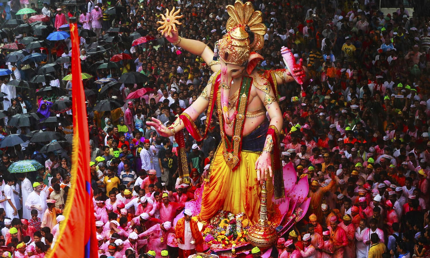 Hindu devotees participate in a procession towards