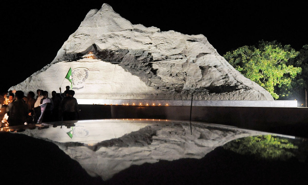 Lamps are lit at the replica of the Chagai Hills set up in Islamabad to mark the anniversary of Pakistan's nuclear tests | Tanveer Shahzad, White Star