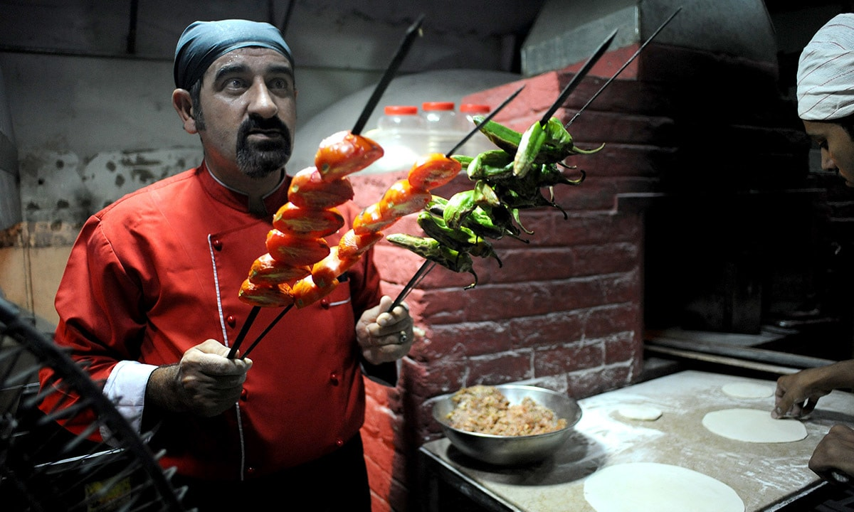 Chef Haydar Acik grills vegetables for Turkish kebabs at Lale-i-Rumi
