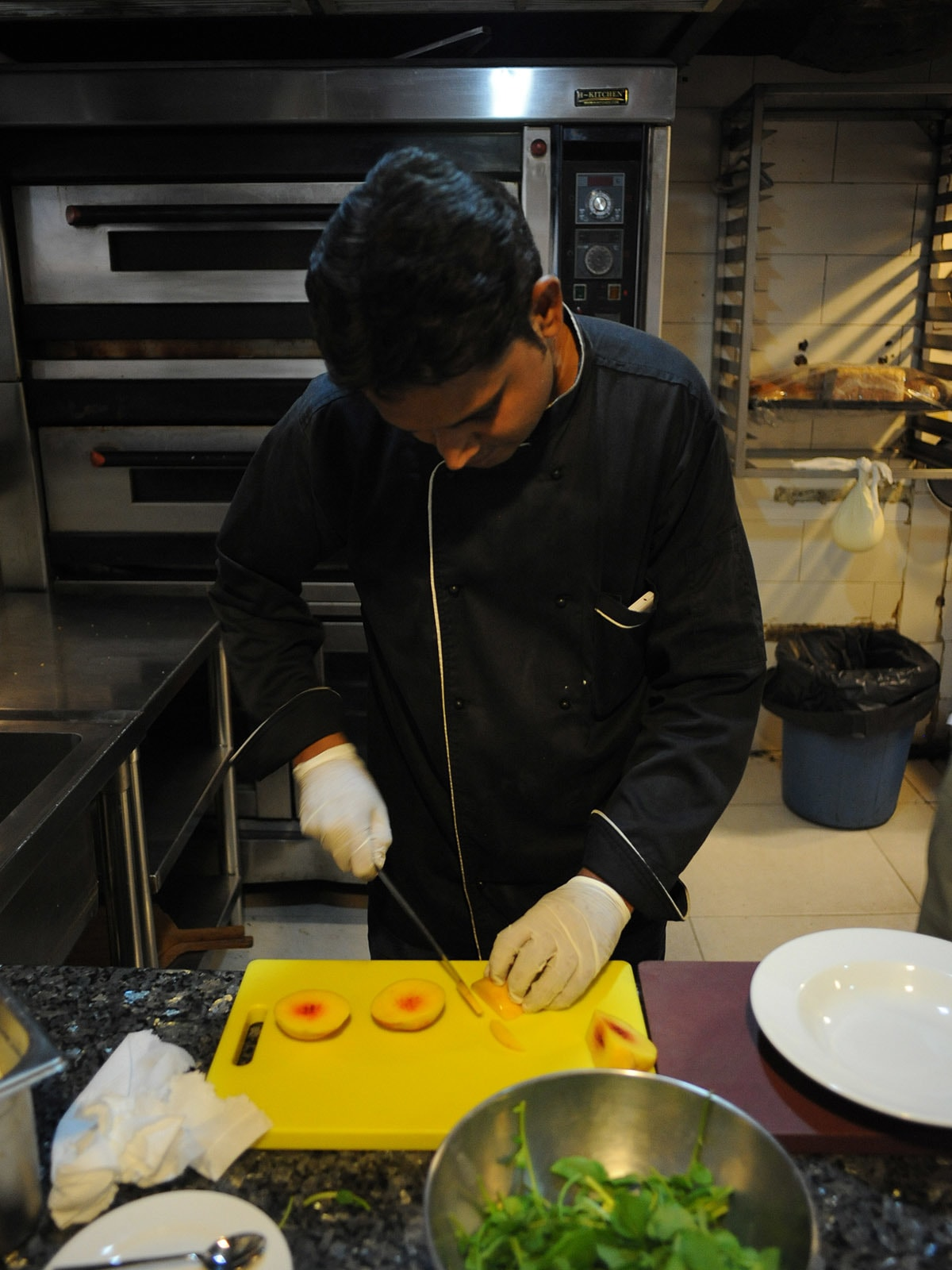 Chef Abdul Samad prepares a salad of fresh seasonal fruits and veggies
