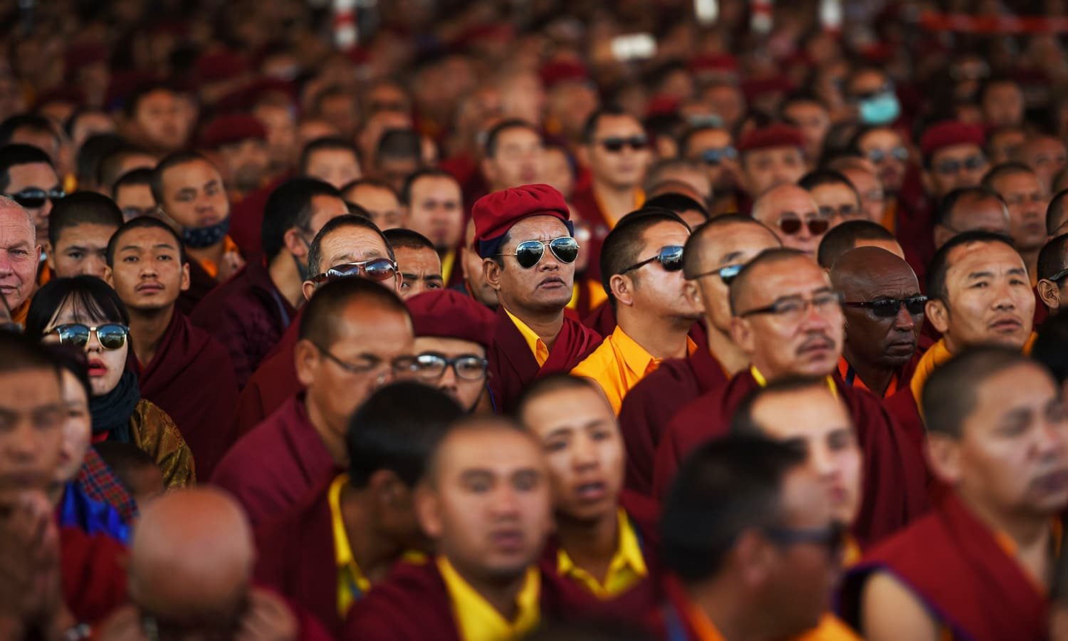 Buddhist monks attend prayer during the Naropa festival. — AFP