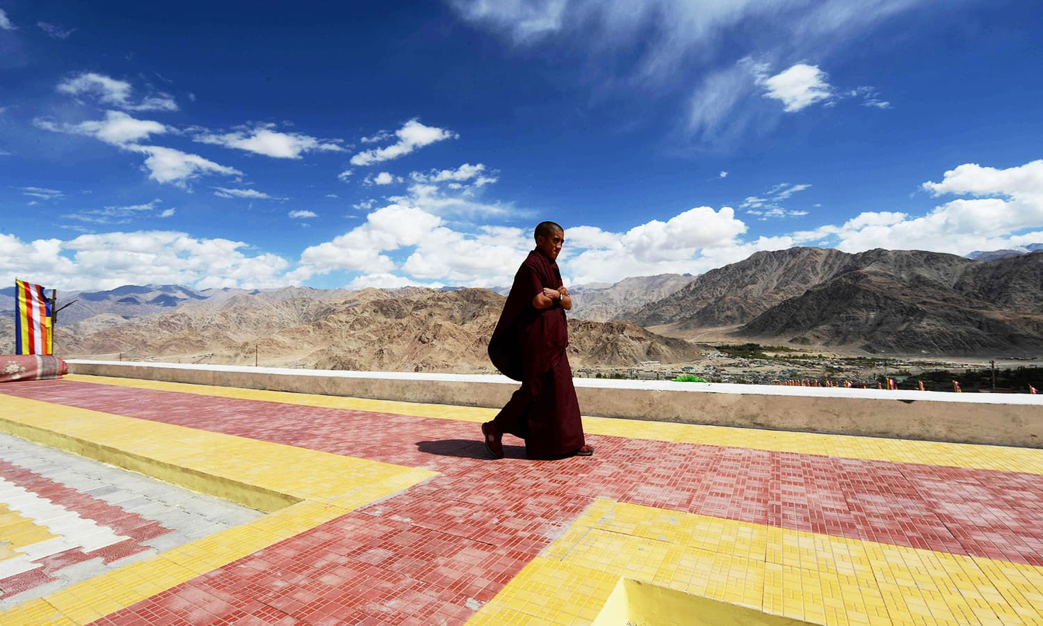 a Buddhist monk walks through the Naro palace during the Naropa festival. — AFP