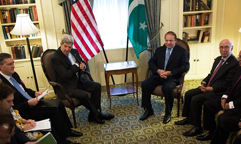 US Secretary of State John Kerry sits with Prime Minister Nawaz Sharif of Pakistan during a bilateral meeting Monday, Sept. 19, in New York.— AP