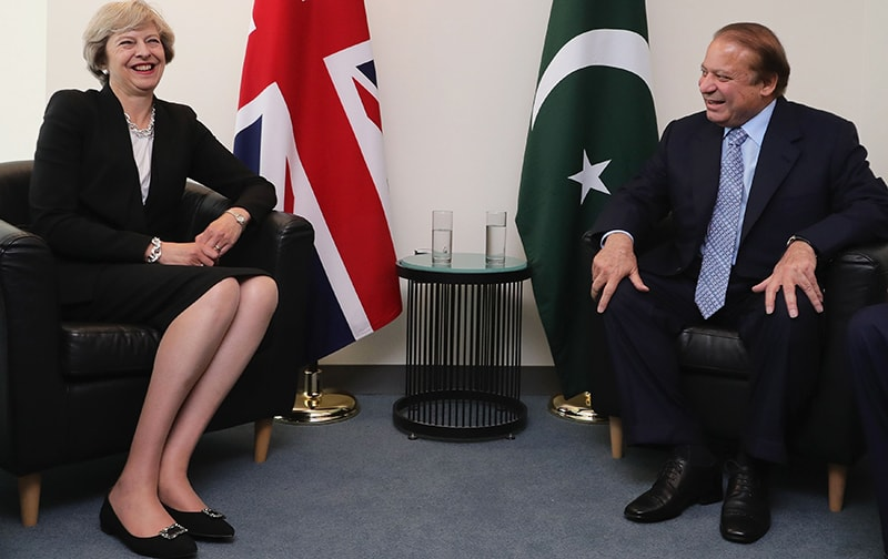 British Prime Minister Theresa May and the Prime Minister Nawaz Sharif talk during a bi-lateral meeting at the United Nations Building in New York City.— AFP