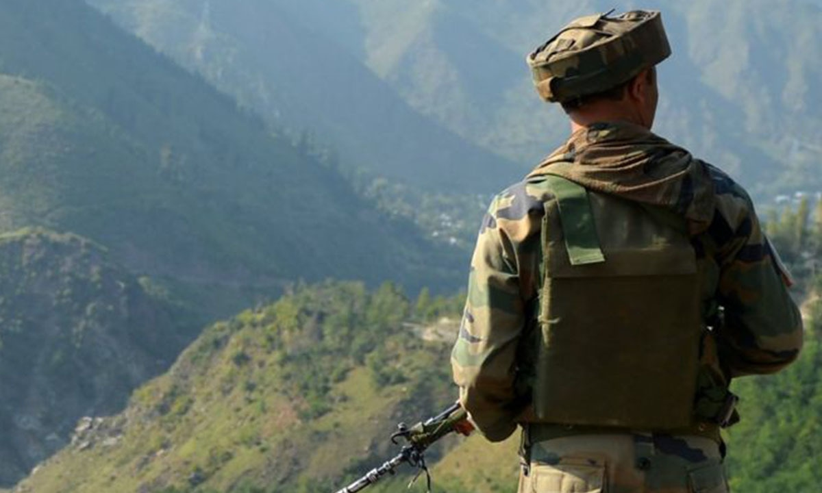 An Indian soldier looks out over the army brigade headquarters at Uri on the day of the attack   AFP