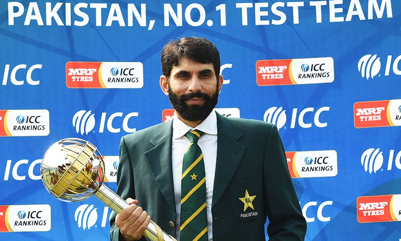 Captain Misbah-ul-Haq holds the ICC Test Championship mace in Lahore. -AFP