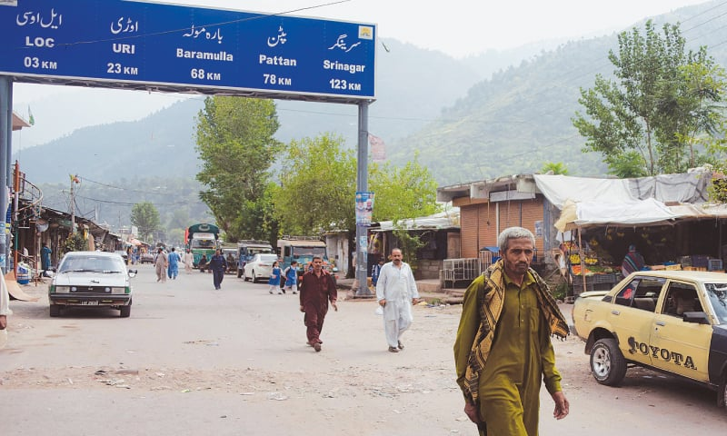 CHAKOTHI: Kashmiris walk along a street on this side of the Line of Control on Wednesday. Despite ties between Pakistan and India hitting new lows and an exchange of fire three days after a deadly raid on an army base in India-held Kashmir that New Delhi blamed on Pakistan-based militants, life in this town of Azad Jammu and Kashmir goes on unhindered.—AFP