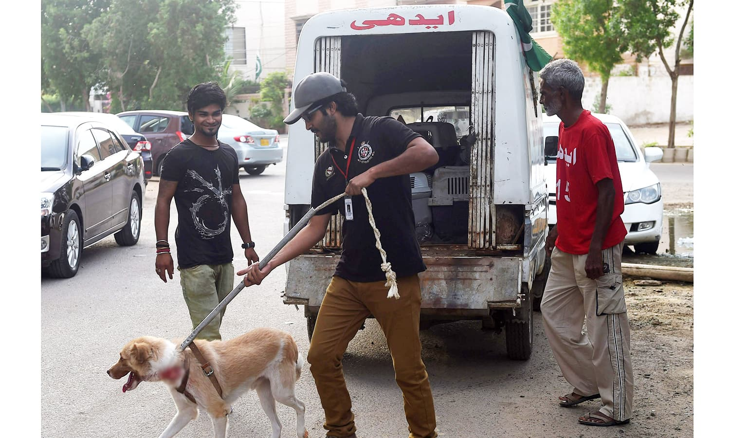 Animal rescuer Syed Mustafa Ahmed arrives with an injured dog at the Animal Care Centre.— AFP