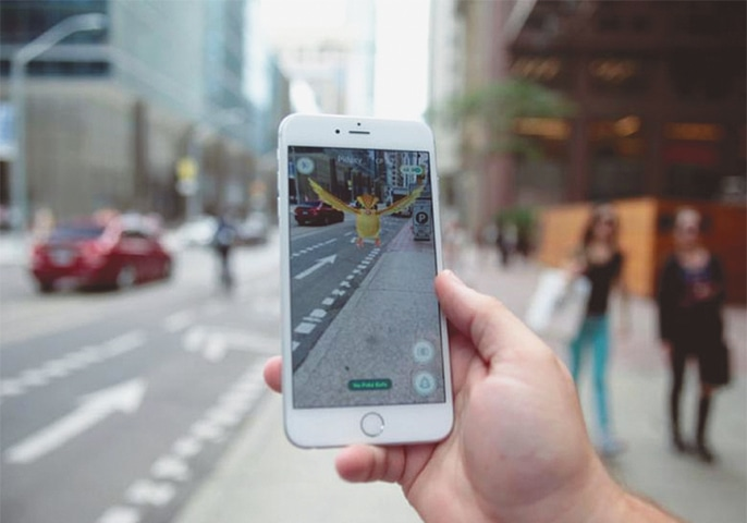 A 'Pidgey' Pokemon is seen on the screen of the Pokemon Go mobile app in a photo illustration taken in downtown Toronto on July 11.—Reuters