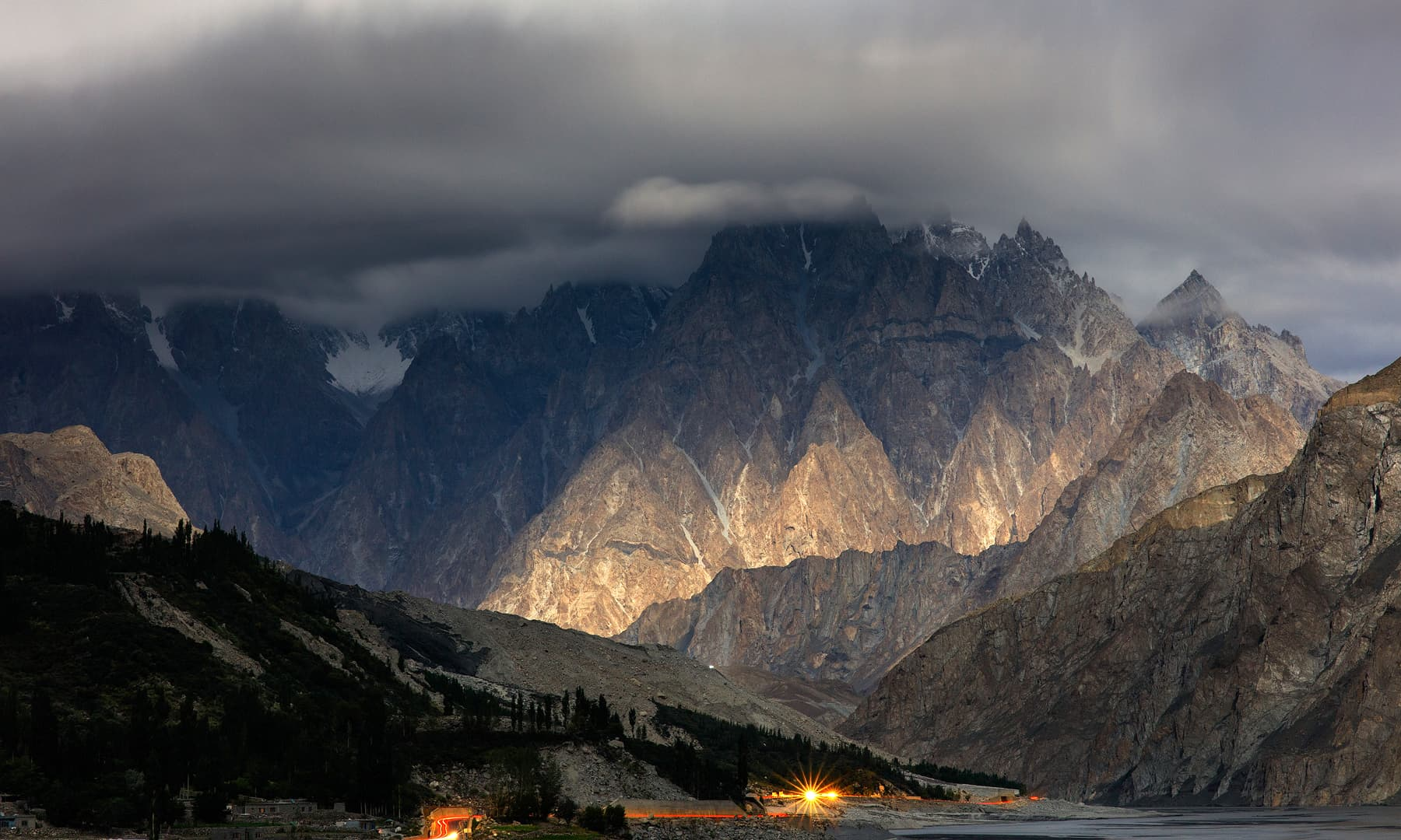 The moonlight blankets Gulmit village as seen from the Karakoram Highway.