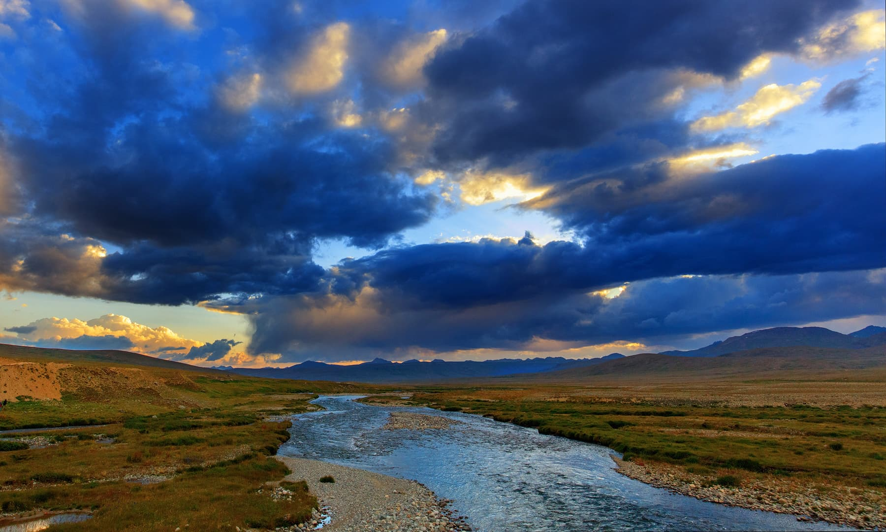 The last rays of sunshine in Deosai bathes the surrounding plains in a golden light.