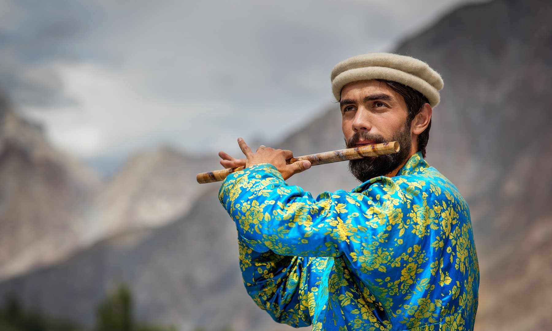 A student practices playing the flute.