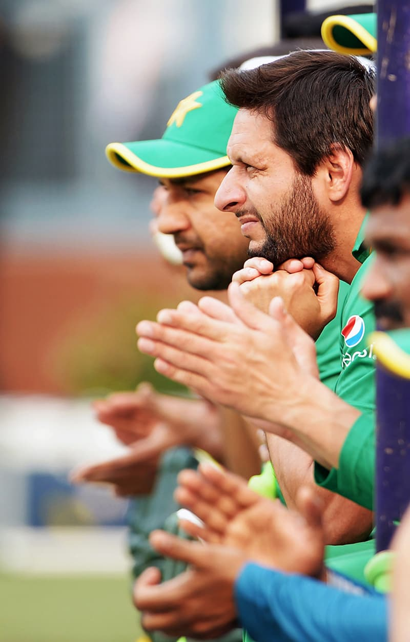 Afridi reacts as he watches a practice match. — AFP