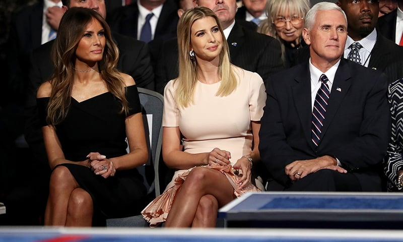Donald Trump's wife, Melania Trump, daughter, Ivanka Trump and Republican VIce Presidential nominee Mike Pence sit during the Presidential Debate at Hofstra University in Hempstead, New York.— AFP