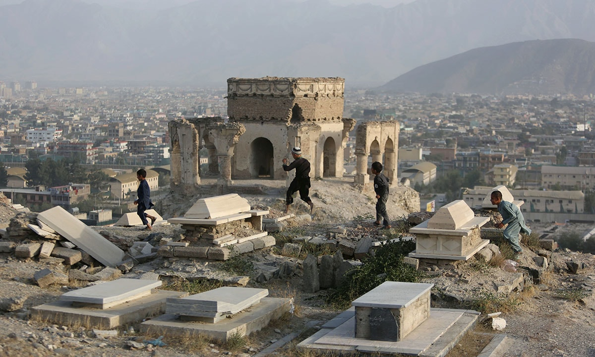 Afghan children play in a cemetery on Nadir Khan Hill in Kabul, Afghanistan | AP