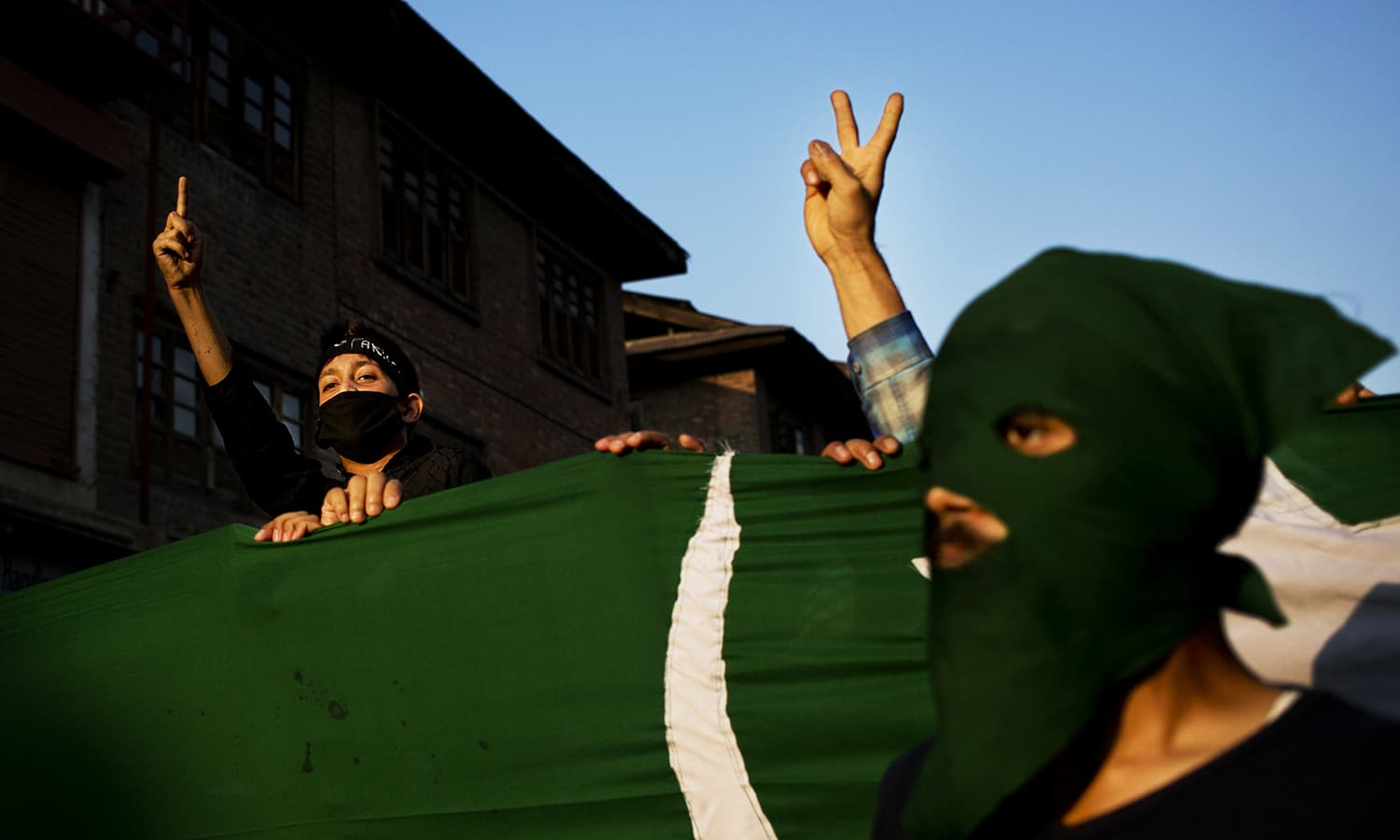 Kashmiri protesters holding a Pakistani flag shout slogans during a protest in Srinagar, Sept 27, 2016. ─ AP