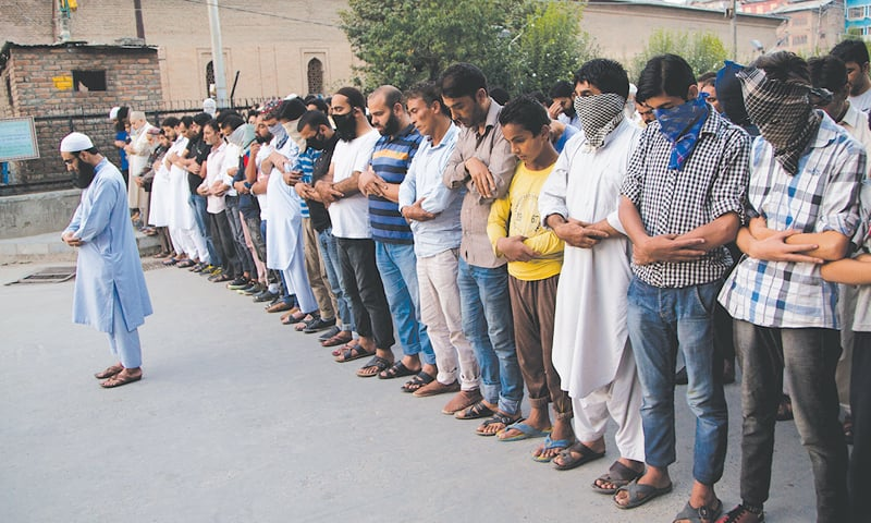 SRINAGAR: Kashmiris on Thursday offer funeral prayers in absentia for the Pakistani soldiers killed in overnight firing by Indian forces on the Pakistani side of the Line of Control.—AP
