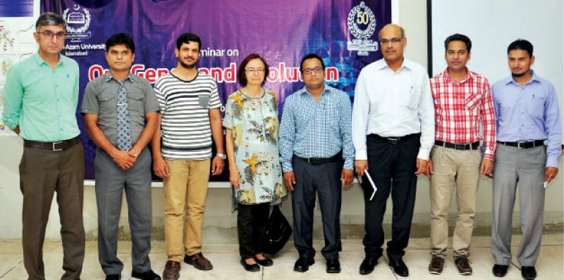 Prof Dr Asli Tolun of Bogaziçi University, Istanbul, with faculty members from QAU Department of Animal Sciences. — Dawn