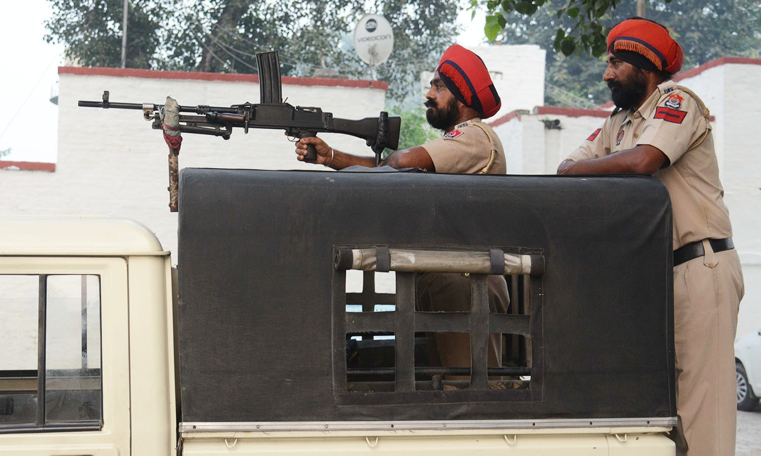 Indian Punjab police personnel stand guard at Attari Railway Station, about 35 kms from Amritsar. — AFP