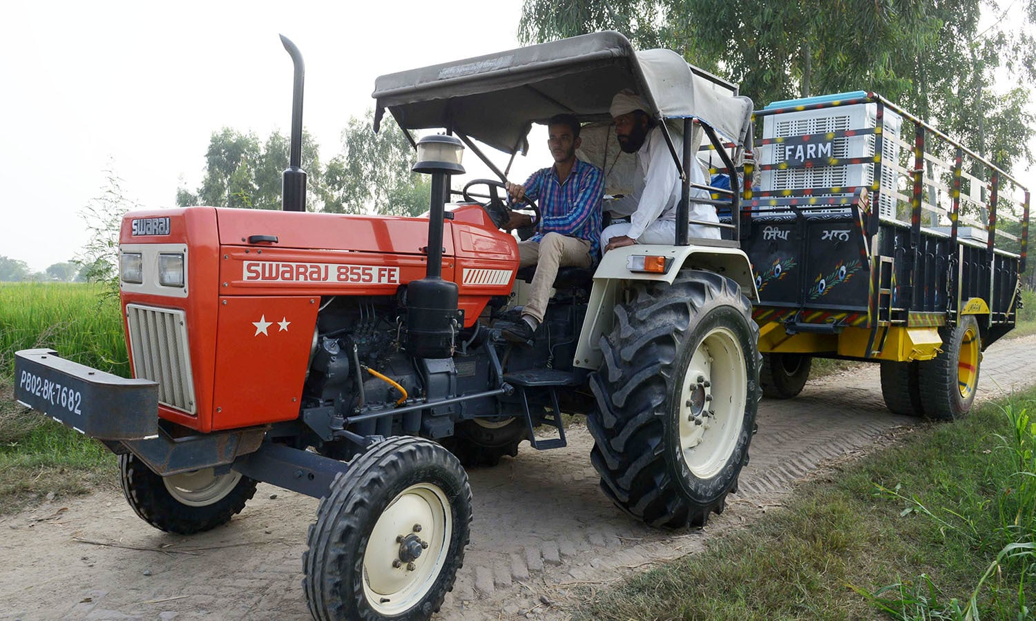 Indian villagers from the India-Pakistan border area ride on a tractor as they evacuate from a border village near Mahawa. — AFP