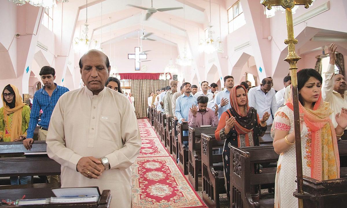 William Barkat (front left) offers prayers at St. Mary's Church   Sara Faruqi
