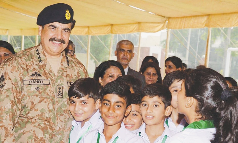 LAHORE: General Raheel Sharif is all smiles as he meets students at the Lahore Garrison Academy on Friday.—PPI