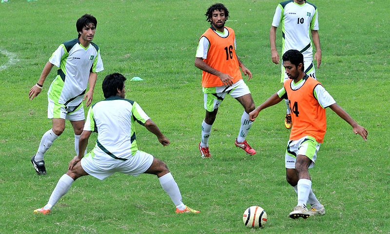 Pakistan football players take part in a training session in Lahore. — AFP/FIle