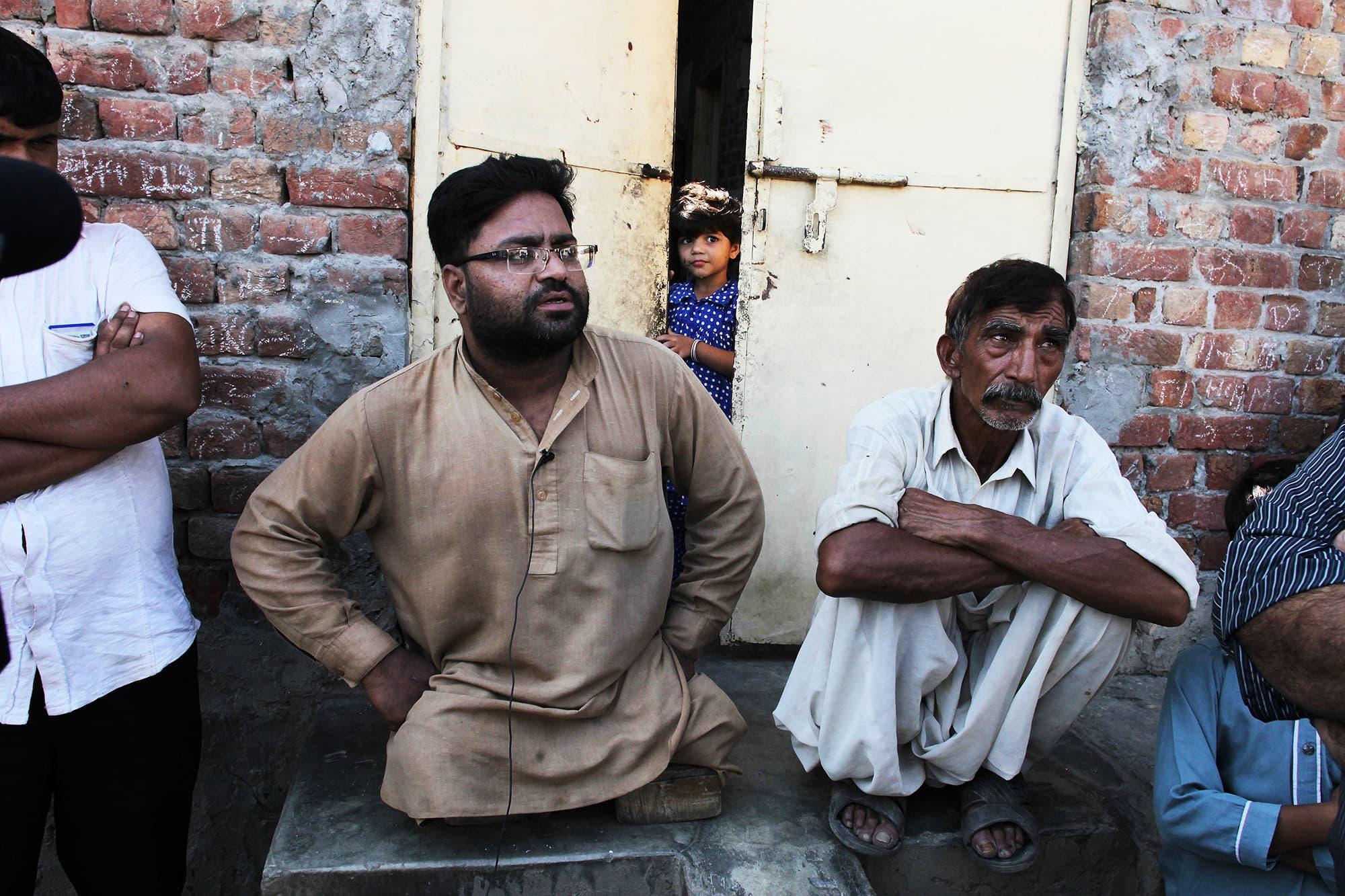 Neighbours of Mubeen Rajhu. — AP