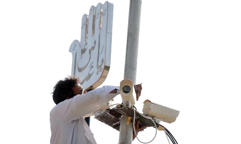 A Technician seen repairing CCTV cameras near Markazi Imambargah in Islamabad. —Online