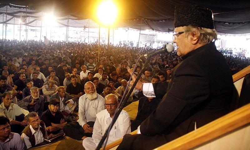 Mourners listen to Allama Talib Jauhari during the first Majlis in Karachi. -Online
