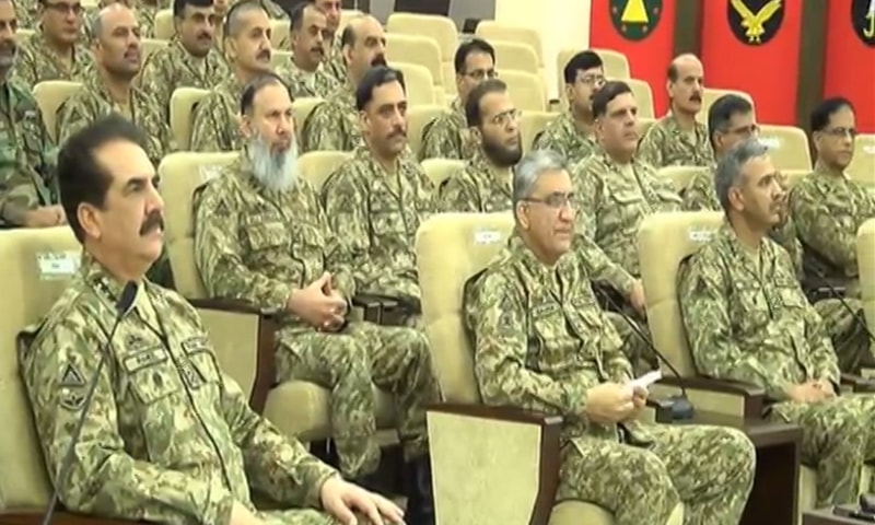 Army Chief Gen Raheel Sharif attends a meeting during his visit to the headquarters of the Strike Corps at Mangla  on Monday.