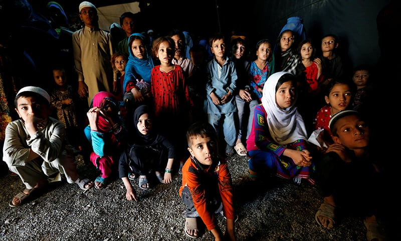 Afghan refugee children, returning from Pakistan, watch a short video clip about mines during a mines and explosives awareness program at a United Nations High Commissioner for Refugees (UNHCR) registration centre in Kabul, Afghanistan Sept 27.— Reuters