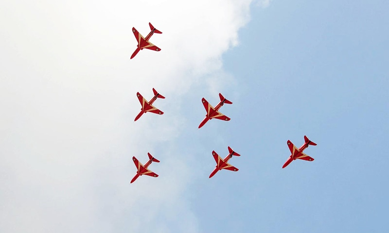 Aircraft of Red Arrows aerobatic team of Royal Air Force seen in the sky on arrival at Karachi. -Courtesy Pakistan Air Force