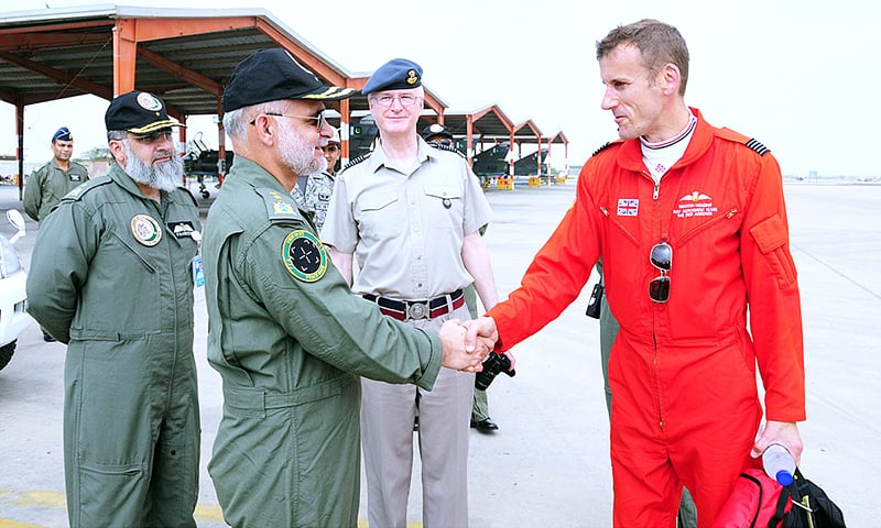 Air Officer Commanding receiving the members of Red Arrows aerobatic team. -Courtesy Pakistan Air Force