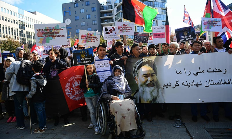 Afghanistan's ethnic Hazaras demonstrate outside the venue of a conference on Afghanistan. —AFP