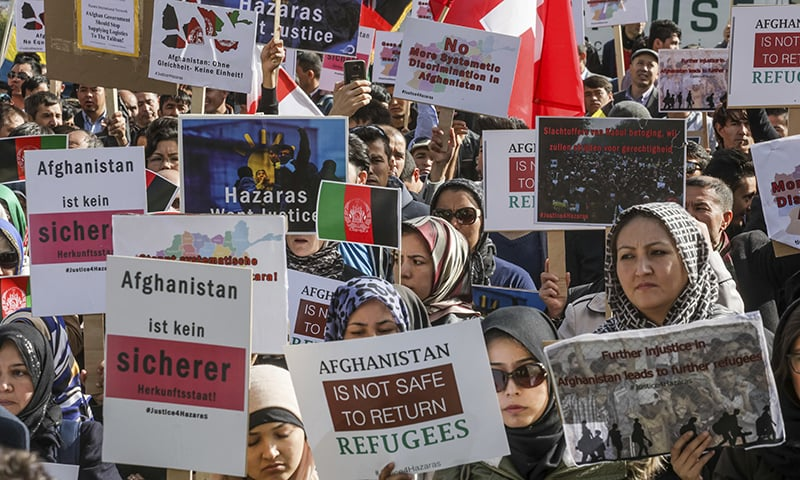 Afghanistan's ethnic Hazaras demonstrate outside the venue of a conference on Afghanistan. —AP