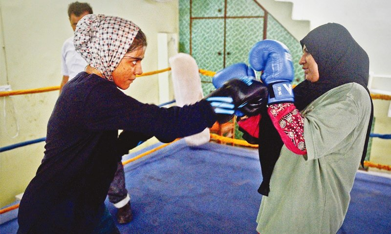 Razia Abdul Aziz and her mother, Halima, in the boxing ring at the Pak Shaheen Boxing Club, where they come to train. —Fahim Siddiqi / White Star