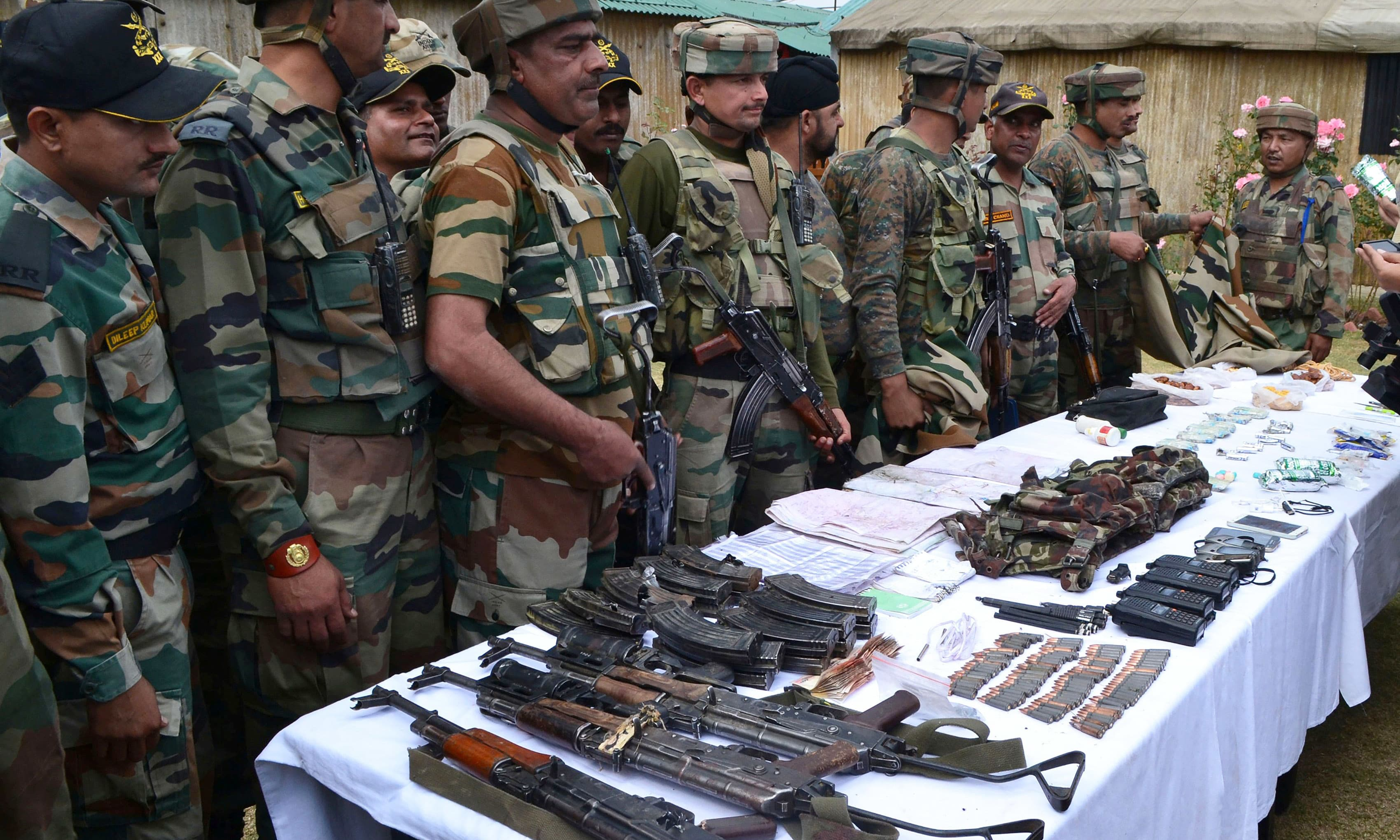 Indian soldiers display arms and ammunation recovered from suspected militants at an army camp in Langate in Kupwara district. —AFP
