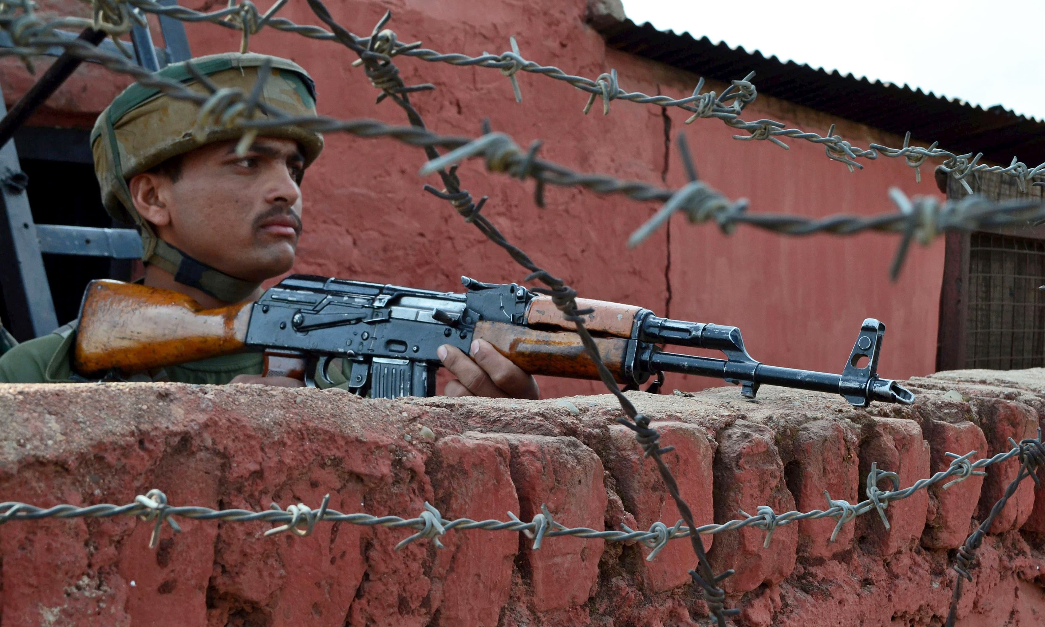 An soldier stands guard following an attack by suspected militants at an army camp in Langate in Kupwara. —AFP