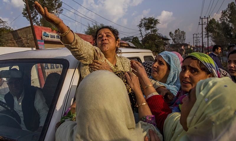 Kashmiri Muslims women comfort wailing mother of Junaid Ahmed.— AP