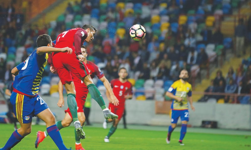 AVEIRO (Portugal): Portugal's Cristiano Ronaldo heads to score during the 2018 World Cup Qualifier against Andorra at the Aveiro Stadium.—Reuters