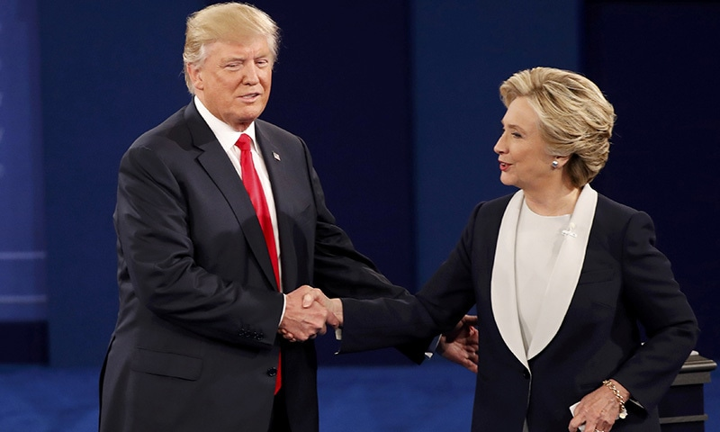 Trump and Clinton shake hands at the conclusion of the debate.— Reuters