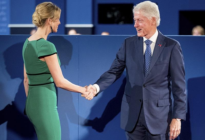 Trump's daughter Ivanka Trump, left, and ex-President Bill Clinton, shake hands before the debate.— AP