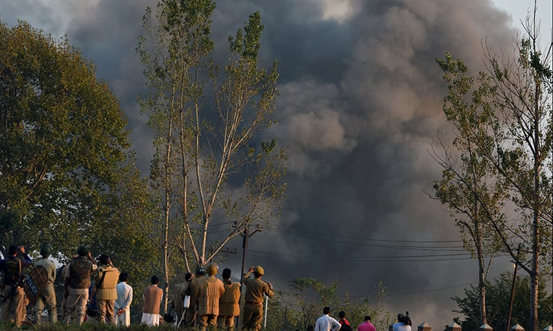 Smoke rises after the Indian army blows up a landmine during a gunfight. ─ AFP
