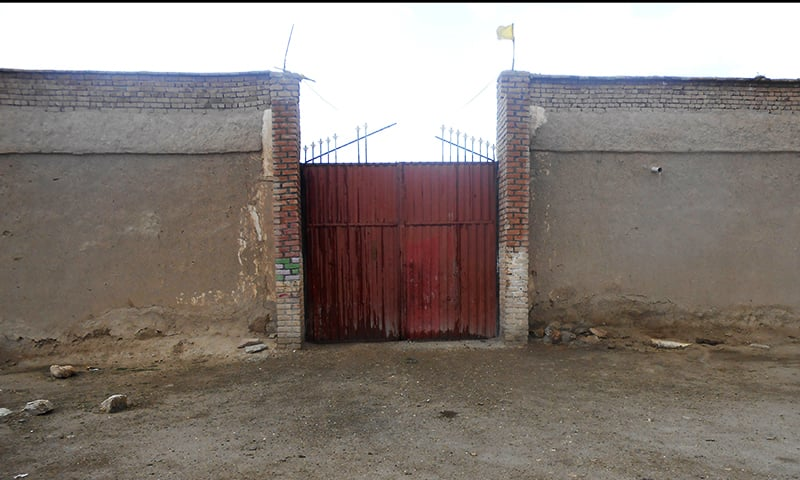 Entrance gate of a tribal elder's house where convict women are kept to serve to their jail term in Paktika province. ─ Reuters