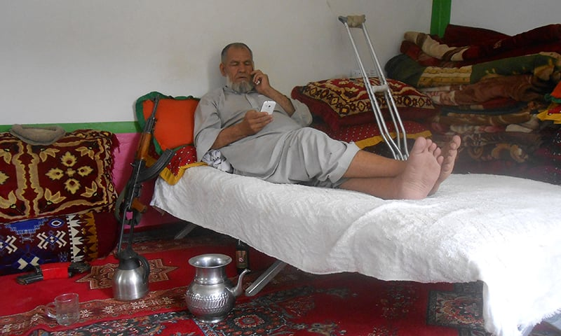 Khalil Zadran, a tribal elder in Paktika, rests on his bed at his house. ─ Reuters