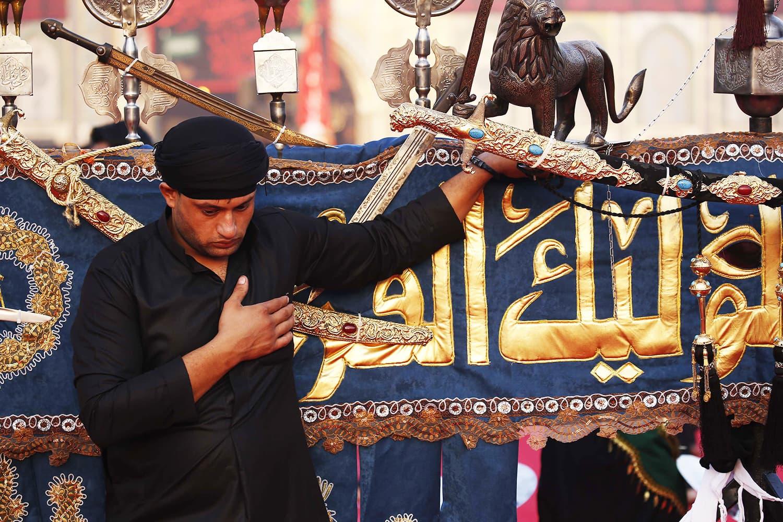 Iraqi mourners take part in commemorations marking Ashura in Karbala. ─ AFP
