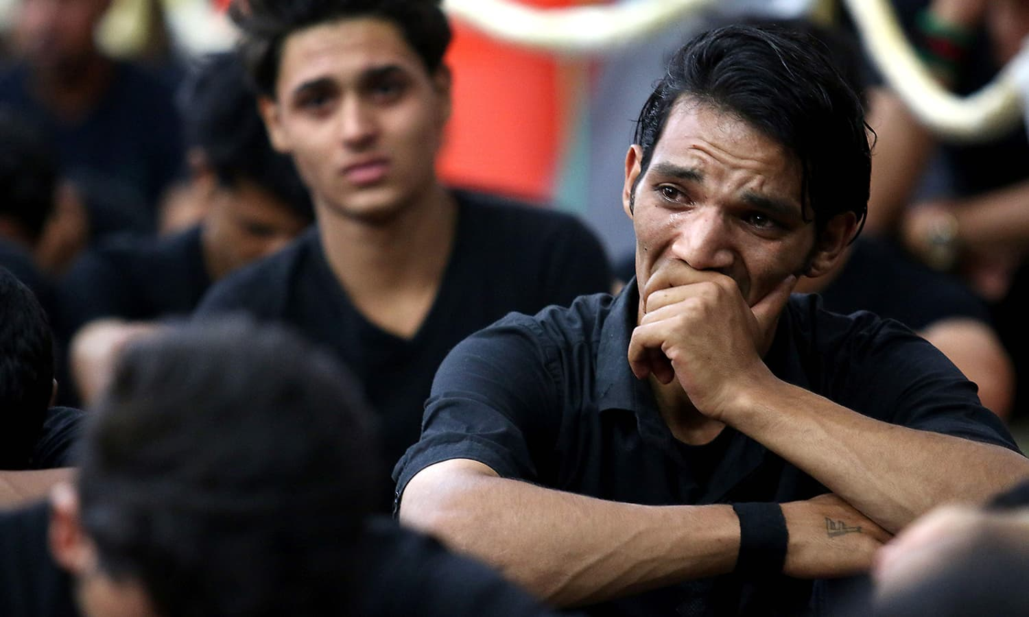 Iraqi men take part in commemorations marking the mourning period of Ashura in the southern city of Basra. ─ AFP