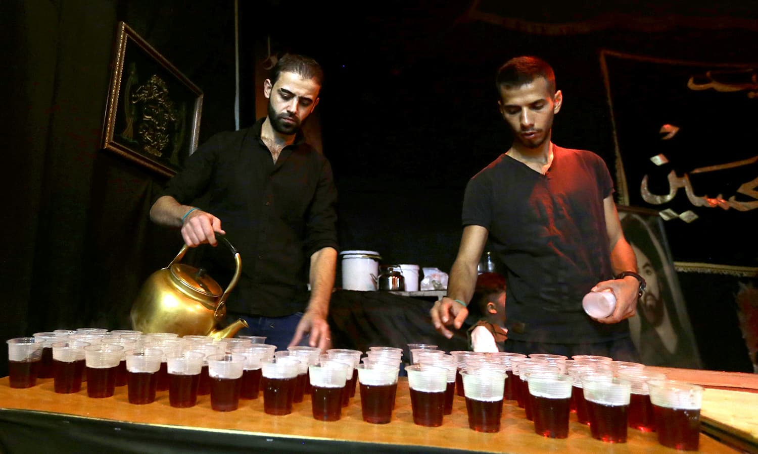 Syrians prepare tea during commemorations marking the mourning period of Ashura in Zine el-Abidine neighbourhood in the capital Damascus. ─ AFP
